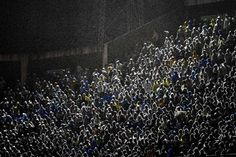 Supporters of Brazilian Chapecoense cheer their team during the 2016 Copa Sudamericana quarterfinals second leg football match against Colombia's Junior held at Arena Conda stadium, in Chapeco, Brazil, on Oct. 26, 2016.Photo by Nelson Almeida/AFP/Getty