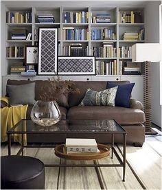 Love the color scheme of bringing in navy with a brown leather couch - Think: Downstairs living room