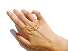 New Celeb Trend: 9 Ways to Wear a Hand Chain like Anne Hathaway via Brit + Co.