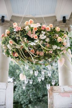 flower chandelier with peach roses,pale pink roses. Kim Starr Wise Greer G Photography -