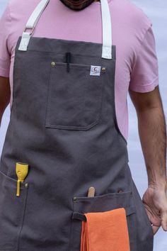 Our cotton webbed strap aprons are economical, durable, high quality and handmade with washed canvas. The trendy style and comfortable fitting of this apron can give anyone an instant makeover. These trendy aprons are a perfect gift for anyone. Cool Aprons, Aprons For Men, Waist Apron, Chef Apron, Apron Designs, Trendy Fashion, Trendy Style, Apron Pockets, Dress Codes