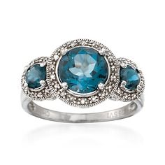 2.90 ct. t.w. London Blue Topaz and .20 ct. t.w. Diamond Three-Stone Ring in Sterling Silver
