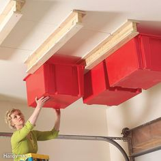 This simple combination of plastic bins and homemade support carriages is perfect for holiday decorations and other rarely needed stuff. To make the carriages, just screw and glue 3/4-in. plywood flanges to 2x4s. Then screw the carriages to ceiling joists and slide in the bins. Get more details on building this system.