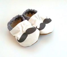Pin for Later: Your Tiny Tot Will Be the Cutest Little Hipster in These Clothes Scooter Booties Mustache Baby Shoes These soft-soled mustache booties ($24) keep little toes warm and cozy in style.