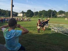 Members of the Marblehead Glover's Regiment welcomed charter schools students to their first day of classes Monday with a prpoer three-volley musket salute.