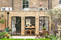 "Hand-formed arches built from reclaimed London Yellow Stock brick kept the extension ""quite traditional,"" Wood noted. A lantern-type roof light also helps elicit the historic significance of this Victorian property. Brick Extension, Orangery Extension, House Extension Design, Extension Designs, House Design, Extension Ideas, Yellow Brick Houses, London Brick, Kitchen Diner Extension"