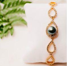 Large black pearl on a teardrop gold bracelet surrounded by cubic zirconia.   #perfect #bracelet #largepearl #blackpearl #pacific #beauty #teardrop