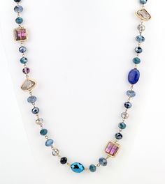 """Opalescent and iridescent beads and blue color hues form a beautiful style long necklace. - 24"""" long, with 2"""" extender - glass/acrylic/gold plated Great if paired with the matching bracelet: Delicate"""