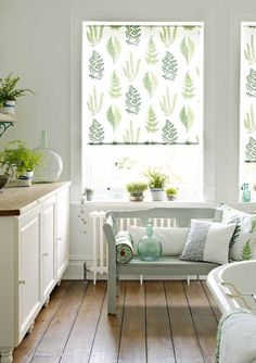 Pale green botanical bathroom with garden bench seating and leaf print curtains , relax!