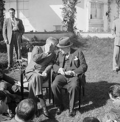 President Franklin D Roosevelt confers with Winston Churchill at a press conference during the Casablanca Conference, 24 January 1943.