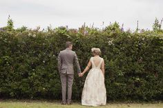 Kat Stanley Photography :: Vintage :: Bride :: Groom :: Outdoors :: Nature :: Flowers :: Holding hands :: Wedding photography
