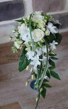 Image result for small cascading wedding flowers with calla lilies and blue berries