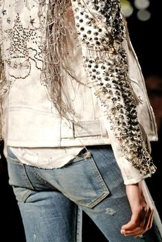 Studded jakket with fringes and safety pins.