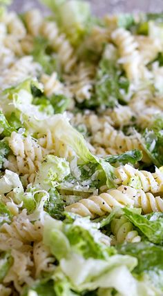Fusilli Caesar Salad ~ A fresh take on the Caesar salad, this pasta salad/green salad hybrid is combined with a homemade dressing for a perfect side dish or potluck salad