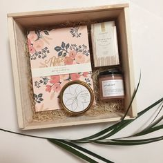 This box includes:Notebook by Rifle Paper & Co.Pink salt scrub by Among the FlowersRosewater sage bar soap by IllumeCoriander lime tin candle by Skeem Desig