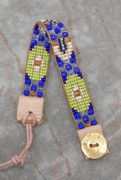 I designed and created this bracelet by hand on my bead loom. I love the way the tiny gold seed beads and faceted fire polished beads catch the light. This bracelet combines cobalt blue, crystal blue, and amber faceted beads with cobalt, white, and lime green seed beads in a modern Southwestern pattern.  This bracelet has an easy to use adjustable closure; just slip the leather loop over the gold toned button and you're set.  Your bracelet will arrive in a gift box, accompanied by a gift…