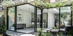Slim framed sliding doors to rear extension sliding away from corner