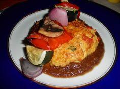Jumbo lump crab spaghetti squash pancake with caramelized onion puree and roasted vegetables