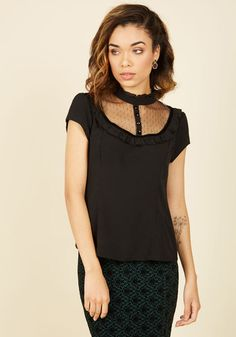 Open your guidebook and educate fellow travelers about the latest locale you visited on vacation - you certainly look expert in this black blouse! Its mesh, ruffled, and velvet-trimmed neckline elevates your ensemble, allowing you to exude confidence as you expound upon landmarks and little-known points of interest.