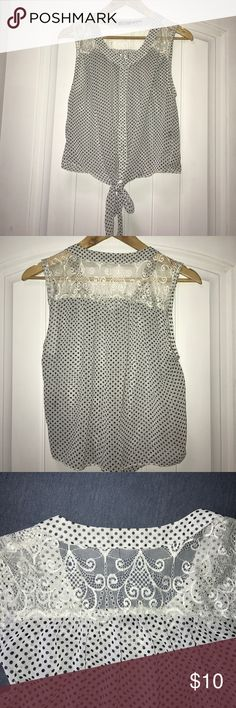 """Poetry Polka Dot Crop Top Sleeveless blouse/crop top with black polka dots and lace detail at the top. Ties at bottom and has matching fabric-covered buttons. Gently used, no rips or stains. 100% polyester Length: 19.5"""" Poetry Tops Crop Tops"""