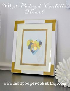 Create unique wall art for Valentine's Day or any time of year! Just use confetti, decoupage medium and any colors of paper that you like.