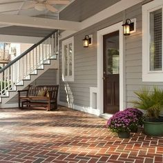 Brick patio under a covered back porch