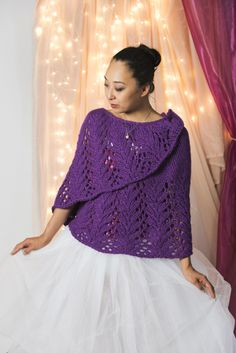 When Clara and her Nutcracker Prince traveled to the Land of Sweets, they were welcomed by the Sugar Plum Fairy. The Land of Sweets Shawl is similarly a welcoming pattern that was designed to keep you warm on a chilly winter's day. This crescent shawl has a wide lace border and is worked from the top down.