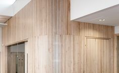 Slatted timber acoustic wall panels.