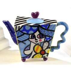 TEAPOT GIRL 48OZ     ROMERO BRITTO CERAMIC    LARGE CERAMIC APPLE DESIGN TEAPOT       Height: 7.50 inches  Width: 5.80 inches        Length: 10.10 inches
