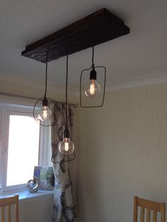 Driftwood dining room light with geomery wire
