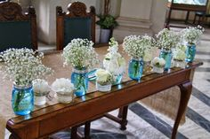 The Registrars Table was dressed with blue Mason Jars were filled with posies of Gypsophilia, small jars and vessels were placed in between each one containing a posy of beautiful Bridal Flowers