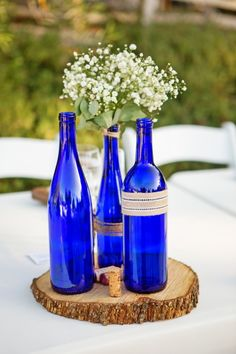 blue bottles for rustic centerpiece