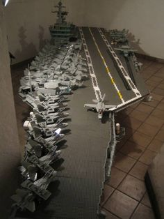 thats right, thats an aircraft carrier built with LEGO. Lego Plane, Lego Boat, Lego Ww2, Lego Army, Lego Aircraft Carrier, Lego Sculptures, Lego Ship, Lego Pictures, Lego Construction