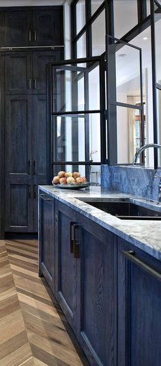 I love the color/finish on these cabinets! They are dark blue (a favorite of mine), but you can still see the wood grain. Beautiful!