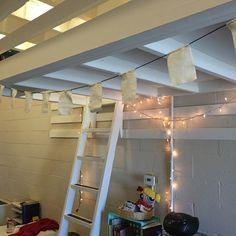 Mini prayer flags under the loft.