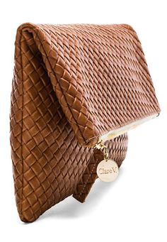 love this woven brown clutch