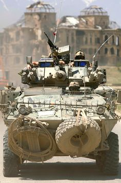 error888:    A Coyote armored reconnaissance vehicle with the Kabul Multinational Brigade armored reconnaissance squadron drives past the ruins of the Kings Palace en route to a checkpoint outside of Kabul Afghanistan (2005). [1057  1600] : MilitaryPorn