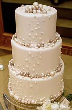 ivory fondant wedding cake with gold and white metallic pearl accents by the pastry studio Wedding Cake Inspiration - The Pastry Studio #weddingideas #weddingcakes #cakes