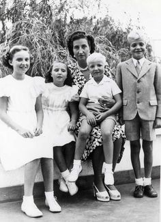 Unofficial Royalty:  Spanish Royal Family late 40s or early 50s l-r  Infantas Pilar (Duchess of Badajoz), Margarita (Duchess of Soria), Maria Mercedes (Countess of Barcelona), Infantes Alfonso and Juan Carlos (now King of Spain)