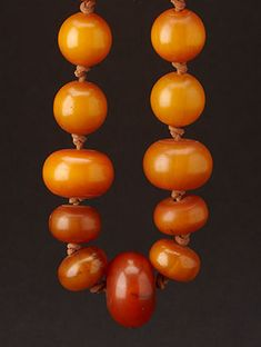 old amber necklace strung on knotted leather - 20""