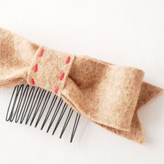 A sweet little felt bow on a hair comb...easy to make and easy to wear!
