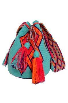 Wayuu Mochilas are hand-woven by women of the Wayuu tribe, a nomadic people who reside in the Guajira region between Colombia and Venezuela. Each mochila is made by a different woman and it takes her approximately one month to complete. Day Party Outfits, Mochila Crochet, Tapestry Crochet Patterns, Ethnic Bag, Tapestry Bag, Boho Bags, Crochet Purses, Mode Style, Handmade Bags