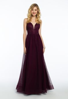 A rich hue is never a bad idea! This gorgeous wine ball gown prom dress features a plunging neckline, fitted bodice, ball gown skirt and open back. Add elegance to your prom night look with rhinestone heels and a top ring box handbag. #CamilleLaVie