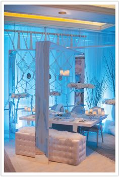 We created a mirrored structure and hung flowers and candles for a  floating centerpiece for this Boho Glam California Winter inspired tablescape. By Alchemy Fine Events www.alchemyfineevents.com