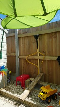 Kids outdoor play area. Water wall. Experiment area. Ikea leaf canopy