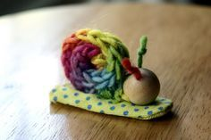 non-doing, not-rushing, or slowing down in summer -- finger-knit snail finger puppets.