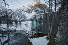 """Juvet, which calls itself a """"landscape hotel"""", aims to be different from other design hotels in that it showcases the nature that surrounds it rather than focusing on its own architecture. The hotel was designed by Oslo-based firm Jensen & Skodvin who say that their intention was to give the feeling that you're outside even though you're protected inside. The hotel consists of nine detached rooms that are sited separately, each with a unique perspective on the rugged landscape. Nature Architecture, Architecture Design, Minimalist Architecture, Glass Cabin, Glass House, Beautiful Hotels, Amazing Hotels, Places To Visit, Around The Worlds"""