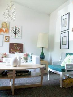 white wall apartment living-you don't have to paint to make it cozy and cute.
