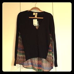 New with tag! Black cardigan w/ colored sheer back Never been worn! Received as gift! New from tag! Anthropologie black cardigan with multi colored sheer back!!! Cotton, nylon and polyester! Beautiful piece in excellent condition! Anthropologie Sweaters Cardigans