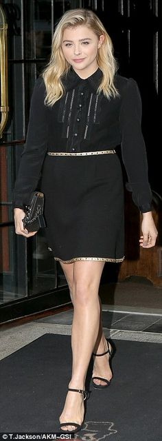 Three's a wow: Chloe looked chic in her third outfit of the day, a little black minidress